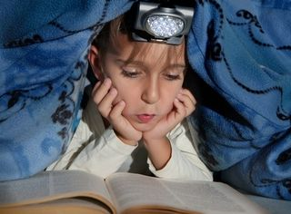 Girl Reads by Flashlight